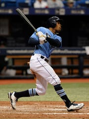 Tampa Bay Rays' Mallex Smith hits a RBI-single off Oakland Athletics starter Jesse Hahn during the fifth inning of a baseball game, Sunday, June 11, 2017, in St. Petersburg, Fla. (AP Photo/Steve Nesius)