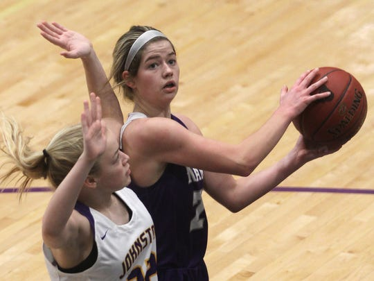 Indianola freshman Mara Bishop looks for a shooting angle around Johnston sophomore Kayla Frickenstein. Indianola 69-28 at Class 5A top-ranked Johnston in a regional semifinal on Feb. 16.