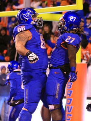 Jay Ajayi (27) punished the Utah State defense for 229 yards rushing and five TDs.