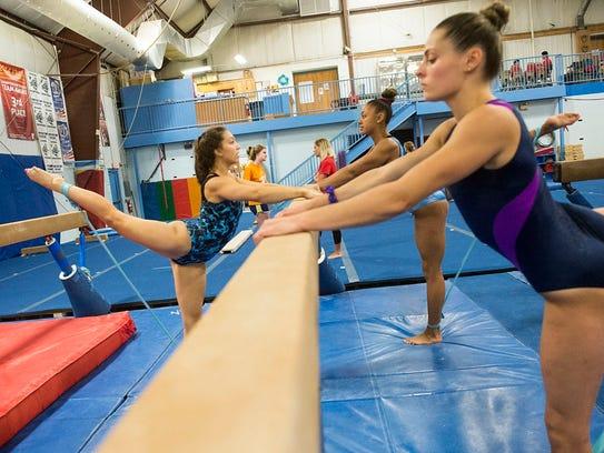 Members of the Hanover YMCA gymnastics team stretch