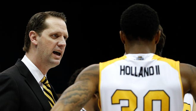 Northern Kentucky head coach John Brannen talks to guard Lavone Holland II (30) during the first half.