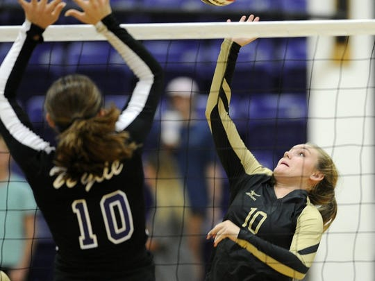 Abilene High's Saige McCray (right) spikes the ball in a 2016 game at Wylie.