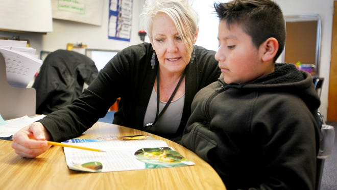 Substitute teacher Maggie Skroski works with Bryan Coto-Nestoso at Bell Elementary March 20, 2017.
