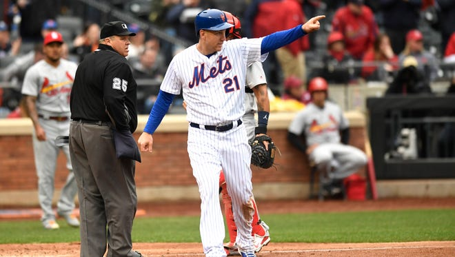 New York Mets third baseman Todd Frazier (21) points to New York Mets first baseman Adrian Gonzalez (23) after his RBI double brought Frazier home. New York Mets face the St. Louis Cardinals on Opening Day at Citi Field in Flushing, NY on Thursday, March 29, 2018.