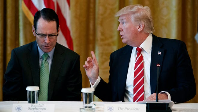 """In this June 22, 2017, file photo, AT&T CEO Randall Stephenson listens as President Trump speaks during the """"American Leadership in Emerging Technology"""" event in the White House."""