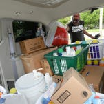 """Stan """"The Recycle Man"""" Melzonthal helps load items donated through the P-I's 12 Months of Giving to the Laundry Project."""