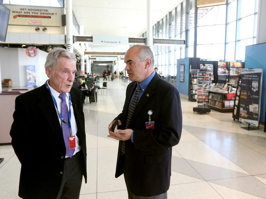 Andy Moore (right) interim airport director and William Johnston, airport construction manager, in the secured area of the airport.  The airport is going through major updates with the help of $39.8 million state grant.