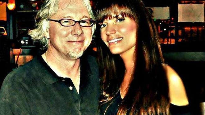 Jennifer Catherine Clegg, shown with R.E.M. band member Mike Mills,  has decided to leave Athens for Colorado to weather the pandemic.