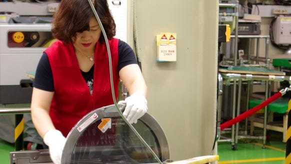A worker assembles part of a TwinWash machine at LG's