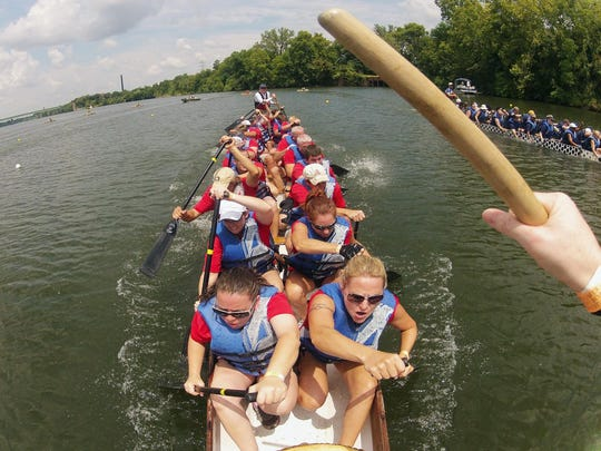 A boat from the Montgomery Dragon Boat Race and Festival competes.