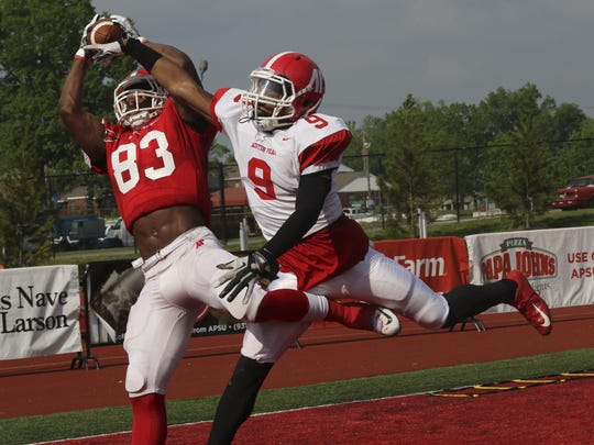 Austin Peay wide receiver Jared Beard, left, catches a touchdown pass during the team's 2016 spring game.