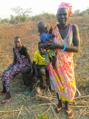 Villagers in Kalthok, South Sudan dress in traditional clothing to celebrate the return of Peter Keny, who grew up in Kalthok before fleeing civil war there in 1989.
