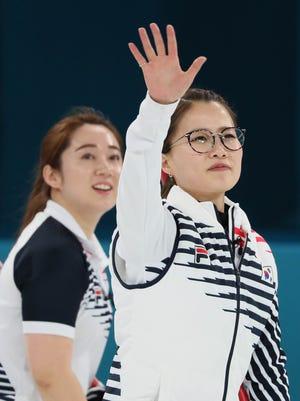 South Korean skip Kim Eun-jung hears the cheers.