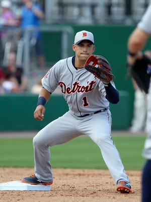 Detroit Tigers shortstop Jose Iglesias waits for the throw from second baseman Ian Kinsler to force out Philadelphia Phillies outfielder Domonic Brown.