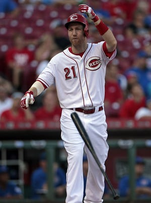 A frustrated Cincinnati Reds third baseman Todd Frazier (21) flips his bat as he pops out in the bottom of the second inning.