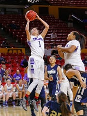 Millennium's Adriana Zelaya shoots over Desert Vista defenders during the second half of their Division I quarterfinal game at Wells Fargo Arena Tuesday, Feb. 23,  2016 in Tempe, Ariz
