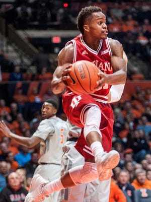 Indiana guard Yogi Ferrell (11) looks for an opening as Illinois guard Jalen Coleman-Lands (5) looks back in Champaign, Ill., on Feb. 25, 2016. Indiana won 74-47.