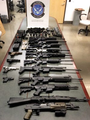 This Monday, Aug. 24, 2015, photo, shows numerous firearms after they were seized at a port in Nogales, Ariz. U.S. Customs and Border Protection says a Phoenix-area woman was attempting to smuggle the weapons, along with several ammunition magazines, into Mexico from Arizona.