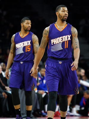 Nov. 19, 2014: Suns forward Markieff Morris (11) and forward Marcus Morris (15) walk on the court during the third quarter against the Detroit Pistons at The Palace of Auburn Hills (Mich.).