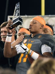 Tennessee quarterback Joshua Dobbs (11) accepts the MVP award at the end of the Franklin American Mortgage Music City Bowl at Nissan Stadium in Nashville on Dec. 30, 2016. Tennessee won 38-24.