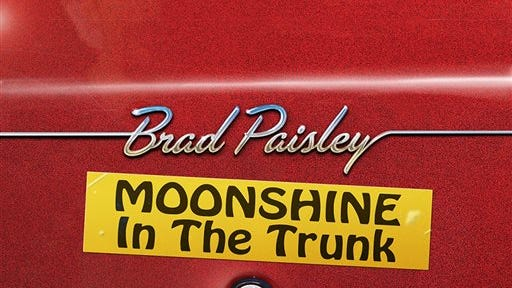 """""""Moonshine In The Trunk,"""" Brad Paisley."""