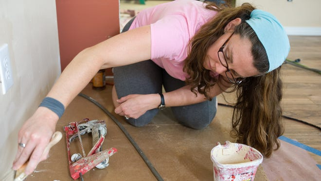 Last September, a group from Salem UCC in Plymouth worked on completing a home in Biloxi, Mississippi, during a mission trip. Pictured, Jennie Schoenefeld works on painting the home. The group is returning to Biloxi in February for another mission trip.
