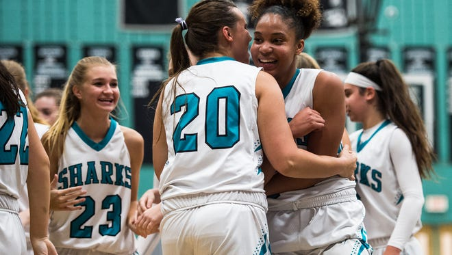 Gulf Coast High School's Yasmeen Chang(24) and Lauren Mcmeekan(20) celebrate a ten point lead over Sarasota during a Class 8A regional quarterfinal in Naples, Fla., on Thursday, Feb. 9, 2017.
