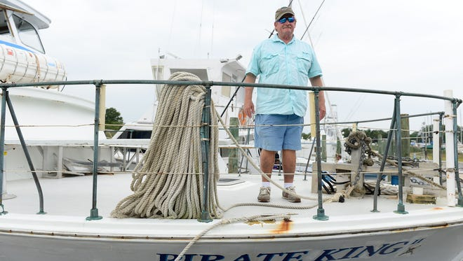 Capt. Ted Moulinier stands aboard his boat the Pirate King II on Monday, August 14, 2017.