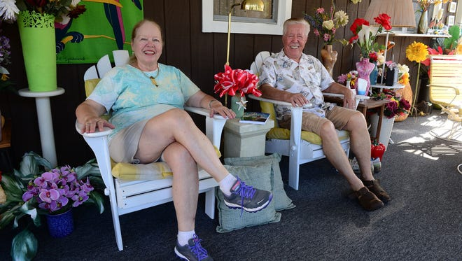 Kathy and Leslie Megyeri sit on their porch at their summer home in Bethany Beach, Del. where they enjoy spending most of their time reading and relaxing.
