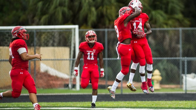 Immokalee High School celebrates a touchdown during a game against Golden Gate High School in Golden Gate on Friday, August 25, 2017.