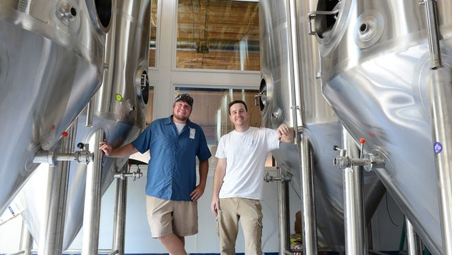 Big Oyster Brewing's Mike Anderson, Sales & Distribution and Andrew Harton, Head Brewer, pose in the new home of Big Oyster Brewing on Tuesday, August 22, 2017.