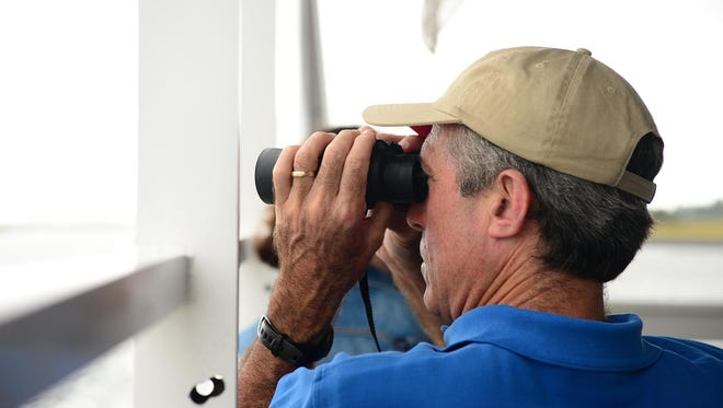 Gov. John Carney looks at local wildlife from aboard the Cape Water Taxi down the Lewes Canal on Wednesday, Sept. 27, 2017.