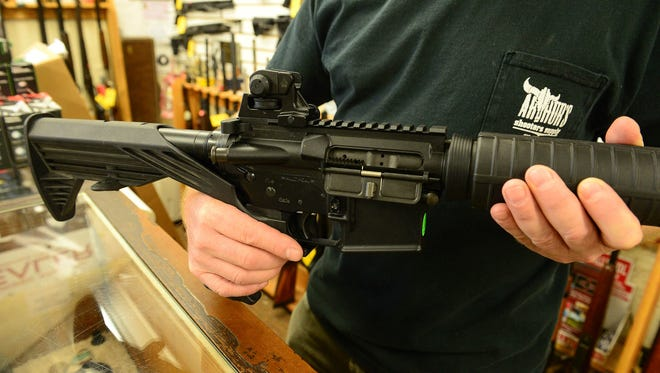 Bob Arthur, Owner of Arthur's Shooters Supply, shows an example of a Maryland Compliant heavy barrel AR15 complete with a bump stock on Thursday, Oct 5, 2017 in Berlin, Md.