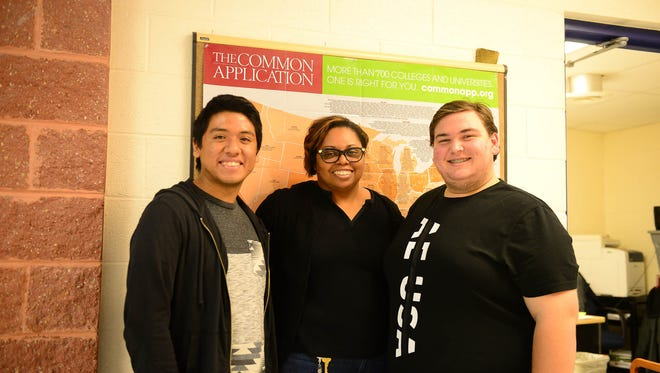 Gerson Deleon, Senior, Nika Reid, Guidance Counselor and Steven Sides, Senior at Sussex Central High School. Stand in front of The Common Application board at their school as they discuss the process for applying for colleges. Monday, Oct. 24, 2017.