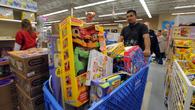 "Toy bargain hunters fill their shopping carts at the Toys""R""Us in the Castleton Shopping Center early Black Friday morning."