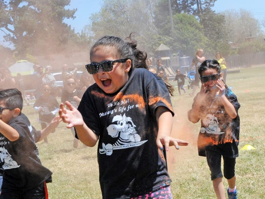 It's orange powder this time around at the Mission Park Elementary School's Pirate Color Run on Wednesday in Salinas.