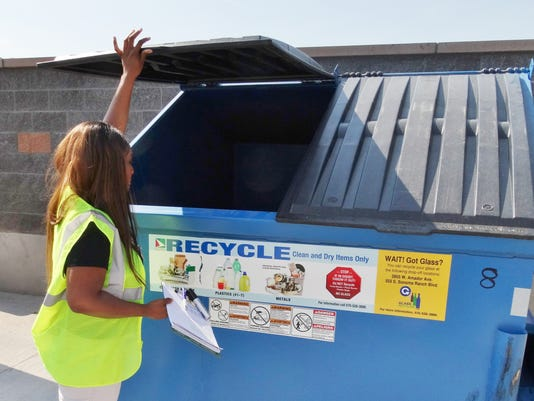 GREEN-CONNECT-1-Keysha-and-empty-blue-bin.jpg