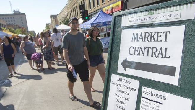 The late September warm weather draws a crowd Saturday, Sept. 23, 2017, to the Oshkosh Saturday Farmers Market.