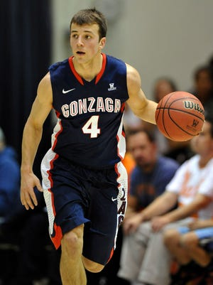 Gonzaga Bulldogs guard Kevin Pangos (4) brings the ball up in the first half against the Pepperdine Waves at Firestone Fieldhouse. Gonzaga defeated Pepperdine 70-53.