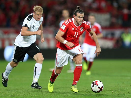 Wales' Gareth Bale, foreground,  controls the ball during the World Cup Group D match between Wales and Austria, at the Cardiff City Stadium, in Cardiff,  Saturday Sept. 2, 2017. (David Davies/PA via AP)