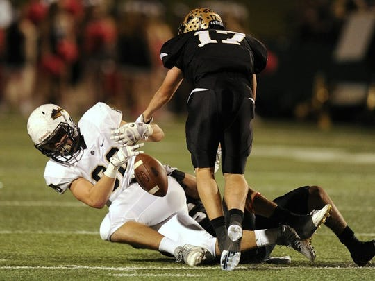 Abilene High defensive back Wes Berry (17) strips the ball away from Keller tight end Brayden Miller (80) during the fourth quarter of the Eagles' 59-21 win on Thursday, Oct. 27, 2016, at Shotwell Stadium.