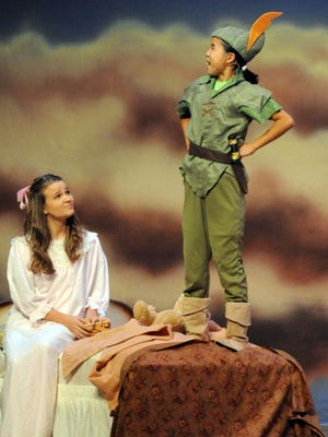 """Peter Pan, played by Jia Radloff, meets Wendy, played by Sydney Schertzer, early in the junior musical production of """"Peter Pan Jr."""" More than 80 young actors and stage crew members, ages 7-17, will stage Disney's """"Peter Pan Jr."""" this Friday, Saturday and Sunday at the Marion Palace Theatre. """"Peter Pan Jr."""" is a more modern version of the well-known tale of a boy who wouldn't grow up. Show times are 7:30 p.m. Friday and Saturday and 2 p.m. Sunday. Reserved tickets are $18 for adults and $12 for students."""