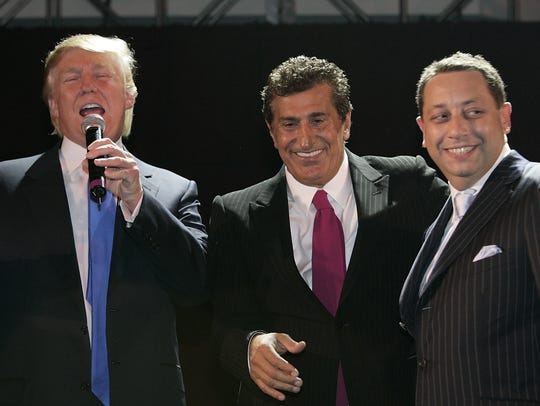 Donald Trump, Tevfik Arif and Felix Sater attend the