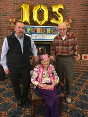 Phyllis Brown celebrating her 105th birthday with grandson Clark Brown (left) and son David Brown at Ashford Commons Senior Living in Westland.