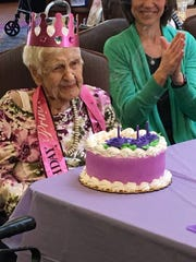 Westland resident Phyllis Brown celebrates her 105th birthday with her favorite cake - carrot - decorated in her favorite color - purple.