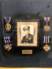 Capt. Arthur H. Allen Jr. and his combat medals.