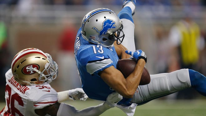 TJ Jones of the Detroit Lions catches a second-quarter touchdown against the San Francisco 49ers at Ford Field on Dec. 27, 2015, in Detroit.