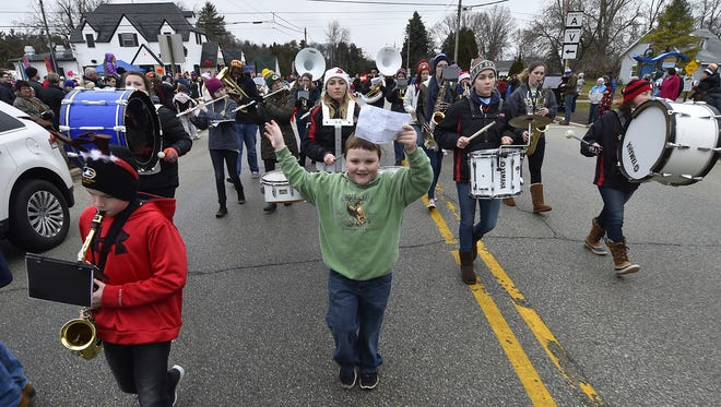 Logan Simon carries on the responsibility of holding up the sheet music for the drumline of the combined Sevastopol-Gibraltar Marching Band during last year's annual Jacksonport Thanksgiving Day Parade. The parade holds the unique distinction of marching a few blocks, then doubling back for a second view for the parade goers.