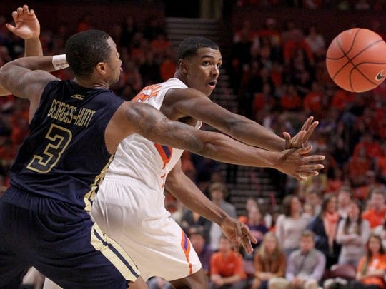 Clemson's Donte Grantham (15) passes the ball as Georgia Tech's Marcus Georges-Hunt (3) defends.