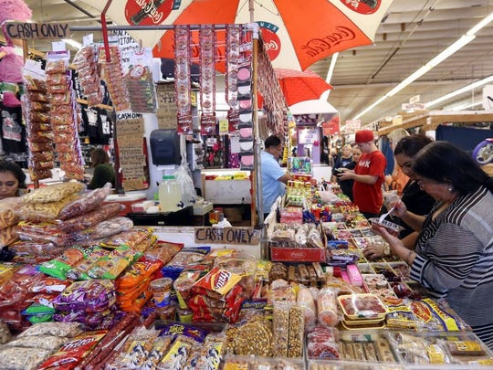 GABE HERNANDEZ/CALLER-TIMES People gather to buy Mexican candy Saturday, Dec. 26, 2015, at the Corpus Christi Trade Center in Corpus Christi.